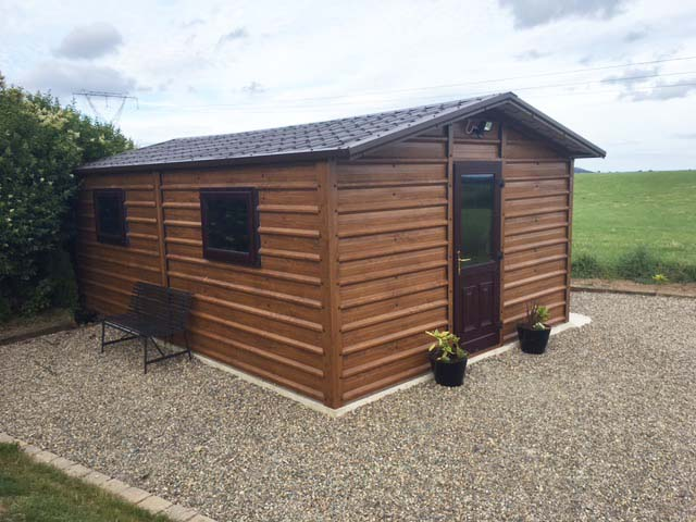 Woodgrain Steel Shed with Tilestyle roof and overhang.